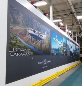 Think wall graphics are just for smaller offices? Think again! This gargantuan mural spans a 70' wall in a local aircraft warehouse.